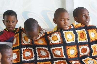 Four Boys from Buckingham School wrapped in wool blanket at Ahhh...Ras Natango workshop