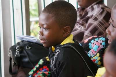 Young boy from Buckingham School absorbed in workshop at Ahhh...Ras Natango