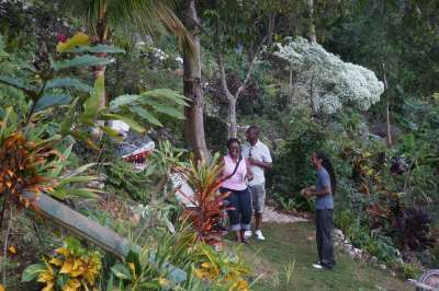 Ayale Williams with Canadian Travel Agents Vanessa and Patrick in the Garden