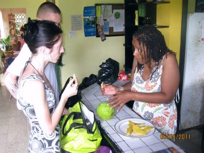 Arlene showing guests how to cook Breadfruit