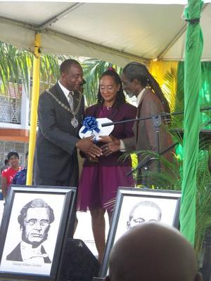 Ian and Tamika Williams recieving the Sam Sharp Award on behalf of the Ahhh...Ras Natango Gallery and Garden